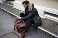 With black pants, dark gray socks, brown shoes and brown big bag
