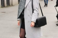 With black skirt, white coat, black bag and high boots