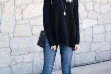 With black sweater, black wide brim hat and mini bag