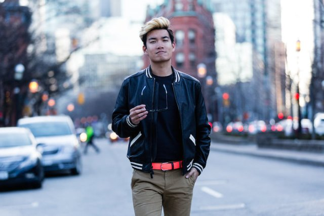 With black t-shirt, gray pants and neon belt