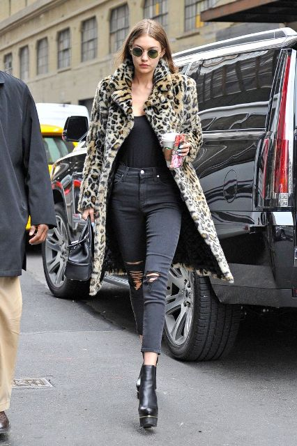 With black top, distressed crop jeans and leopard print coat