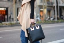 With black turtleneck, black boots with metallic heels, tote and beige cape