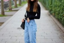 With black turtleneck, white sneakers and bag