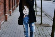 With blouse, brown boots, wide brim hat and black coat