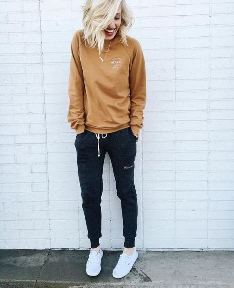 With brown sweatshirt and white sneakers