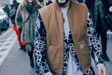 With brown vest, printed blazer, jeans and bag