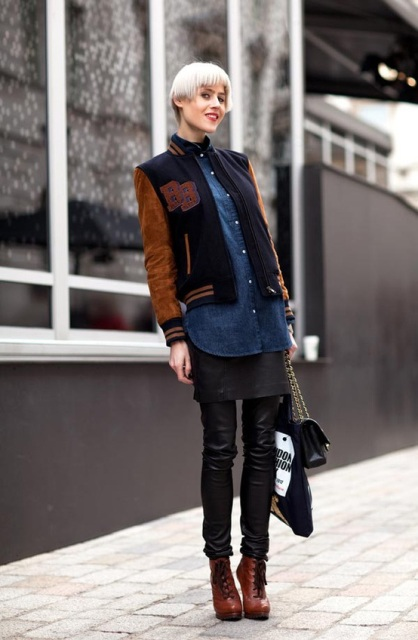 With denim shirt, leather pants, brown ankle boots and chain strap bag