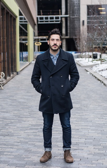 With double-breasted coat and lace up shoes