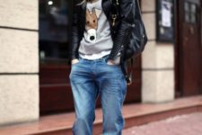 With funny sweatshirt, black platform boots, gray beanie and black leather jacket