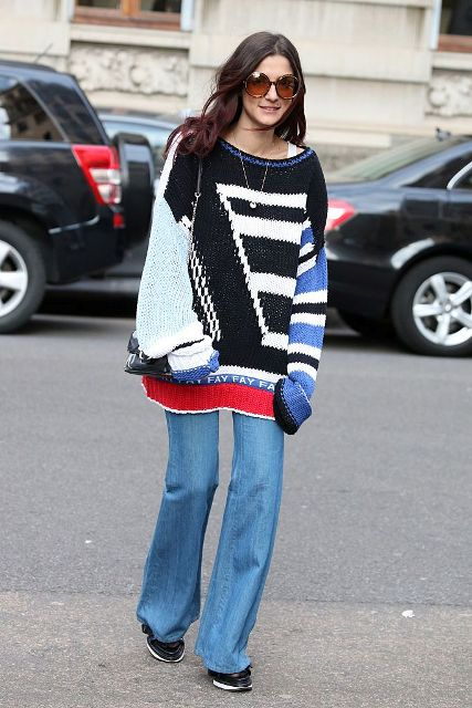 With geometric printed sweater and sneakers