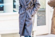 With gray belted coat and metallic boots