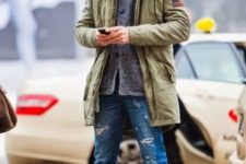 With gray cardigan, distressed jeans, gray beanie and marsala boots