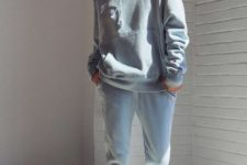 With gray hoodie and white sneakers