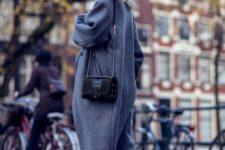 With gray midi coat, crop jeans and black mini bag