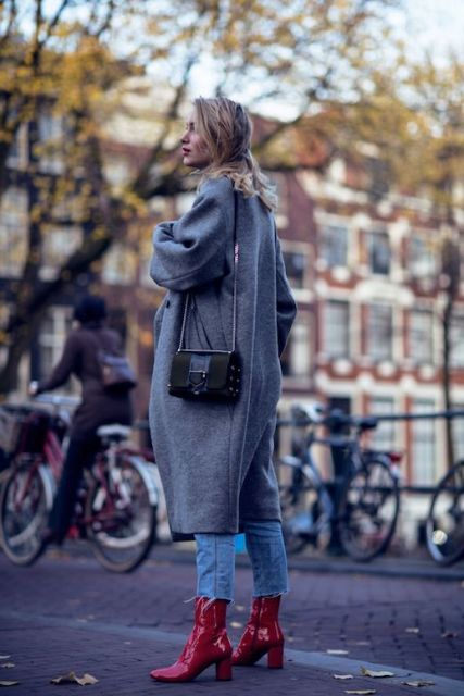 With gray midi coat, crop jeans and black mini bag