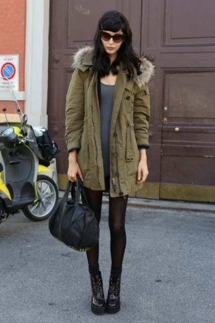 With gray mini dress, platform boots and black bag