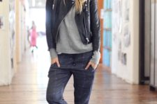 With gray shirt, leather jacket and two color sneakers
