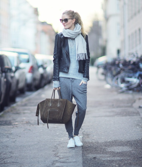 With gray shirt, leather jacket, white sneakers and suede bag