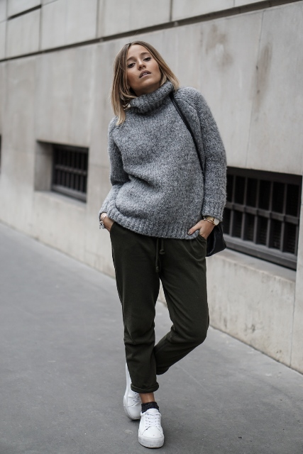 With gray sweater, black bag and white sneakers