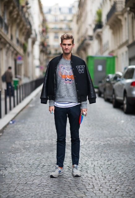 With gray sweatshirt, jeans and gray sneakers