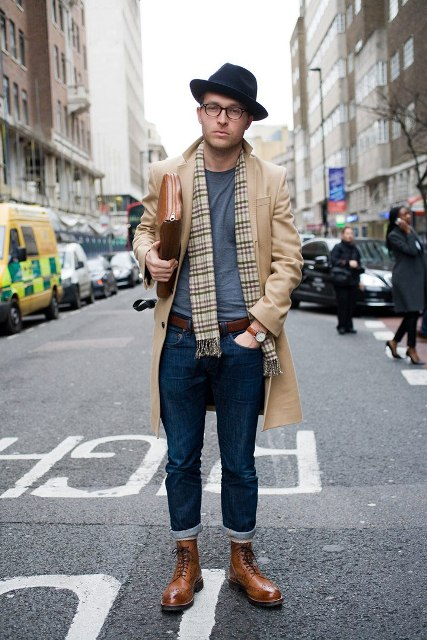 With gray t-shirt, cuffed jeans, printed scarf, camel coat, brown leather boots and bag