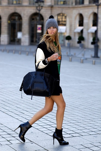 With green shirt, mini skirt, leather boots, big bag and gray beanie