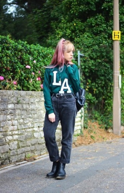 With green sweater, black boots and backpack