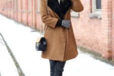 With leather pants, brown coat with fur collar, white beanie and chain strap bag