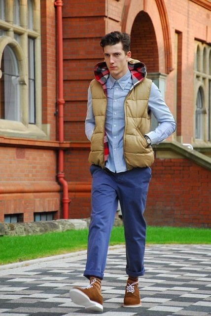 With light blue shirt, puffer vest and brown suede boots