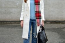 With light blue shirt, white coat, black shoes and black tote