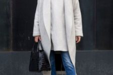 With long shirt, black shoes, black socks, beige midi coat and black bag