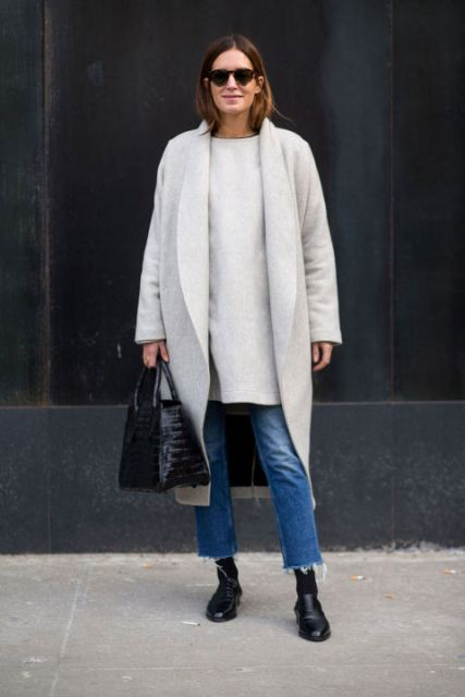 With long shirt, black shoes, black socks, beige midi coat and black bag