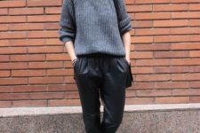With loose sweater and loafers