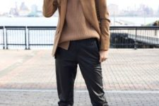 With loose sweater, camel jacket and black boots