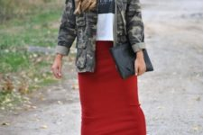 With loose t-shirt, military jacket, clutch and red mini skirt