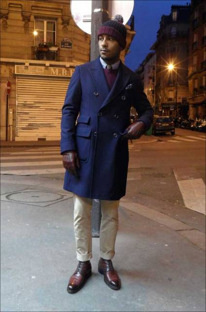 With navy blue coat, beanie and leather shoes