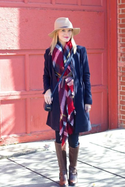 With navy blue coat, beige hat, crossbody bag and brown high boots
