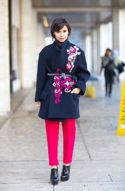 With navy blue coat, belt and hot pink trousers