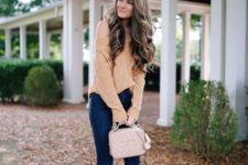 With off the shoulder sweater, beige boots and pale pink bag