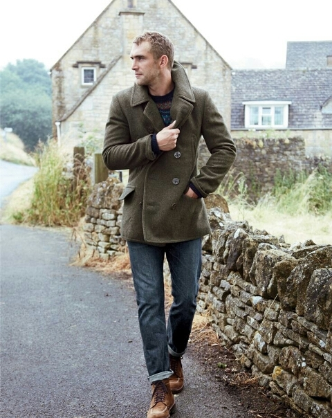 With olive green jacket and brown shoes