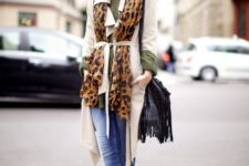 With olive green shirt, leopard print scarf, white trench coat, fringe bag and cuffed jeans