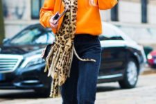 With orange sweater, leopard printed scarf and cutout shoes