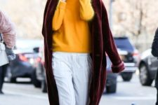 With orange sweater, marsala fur coat and platform boots