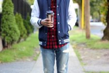 With plaid shirt, distressed jeans, cap and sneakers