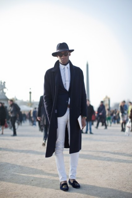 With polka dot shirt, white tie, navy blue jacket, white pants, black loafers and coat