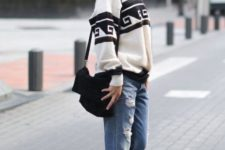 With printed loose sweater, white sneakers and black bag