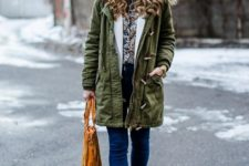 With printed shirt, jeans, orange fringe bag and ankle boots