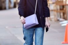 With purple jacket, white sneakers and crossbody bag