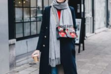 With red shirt, cuffed jeans, navy blue midi coat, gray scarf and printed bag