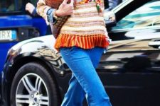 With shirt, colorful sweater and brown boots